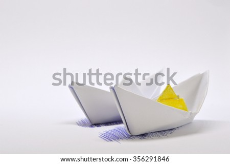 Two White Paper Boats isolated on a white background
