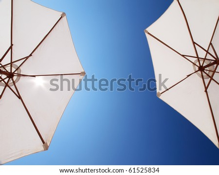 two white parasol directly above - stock photo