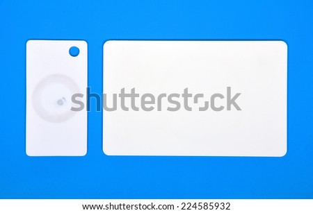 two white RFID cards on a blue background - stock photo