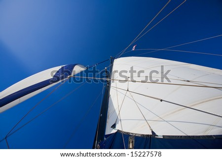 Two white sails against blue sky - stock photo