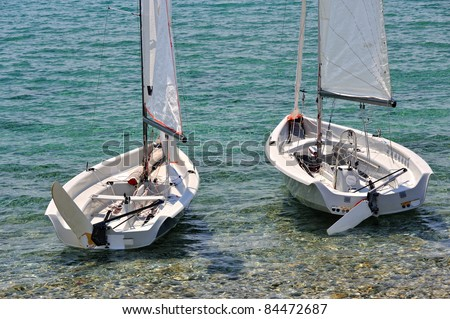 Two white small sailboats