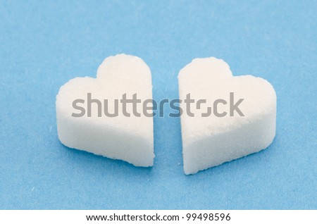 two white sugar hearts on azure background