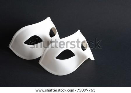 Two white venetian masks on black background - stock photo