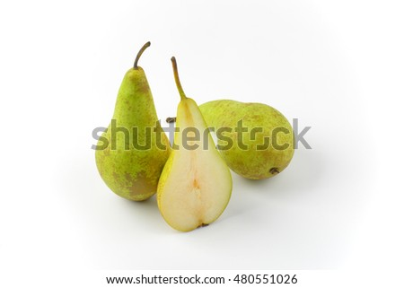 two whole fresh green pears and one half