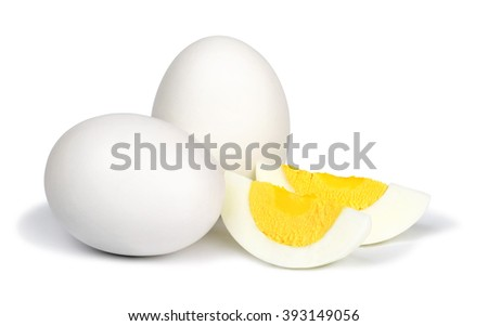 Two whole unpeeled boiled eggs and two slices of eggs isolated on a white background. - stock photo