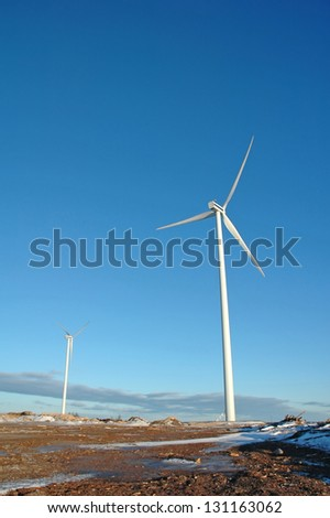 two wind turbine generating electricity at seaside in Sweden - stock photo