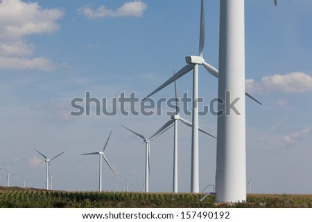 Two wind turbines near the coast producing alternative energy