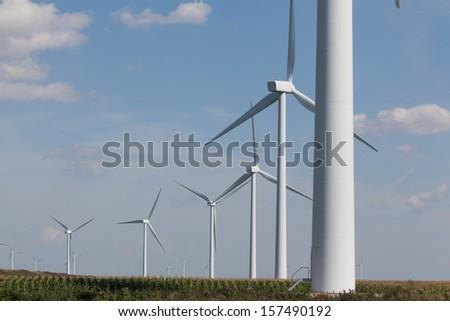 Two wind turbines near the coast producing alternative energy - stock photo