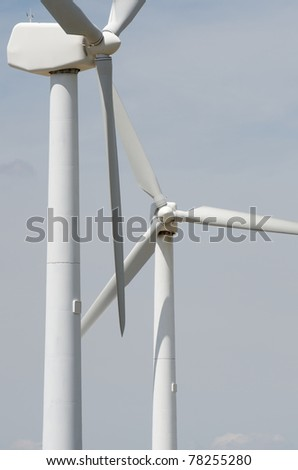 two windmills  for renewable electric energy production - stock photo