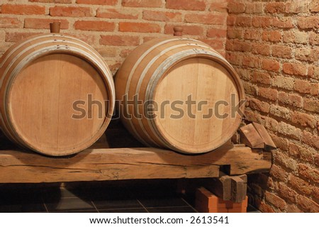 Two wine barrels in cellar - stock photo