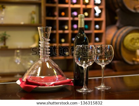 two Wine glass and decanter on a wooden Background in a winery - stock photo