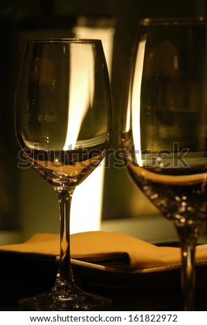 Two wine glasses adorn the table. - stock photo