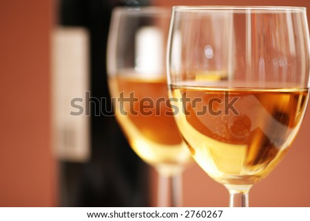 Two wine glasses and a bottle a wine - stock photo