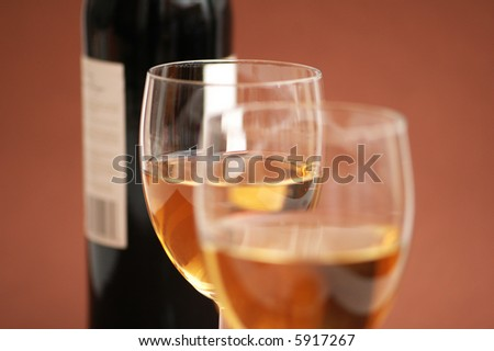 Two wine  glasses and a bottle of wine - more similar photos in my portfolio - stock photo