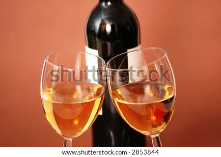 Two wine glasses and bottle of wine - stock photo