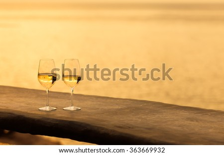 Two wine glasses in a beautiful setting.  - stock photo