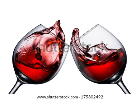 Two wine glasses with wine splash - stock photo