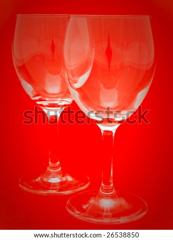 two wineglasses over the red background