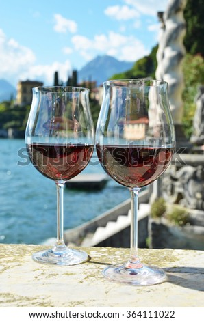 Two wineglasses. Varenna town at the lake Como, Italy - stock photo