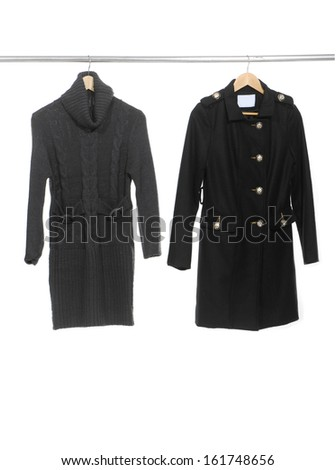 Two woman black clothes on a hanger - stock photo