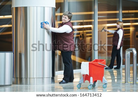 two woman cleaner worker in uniform cleaning indoor interior of business building - stock photo