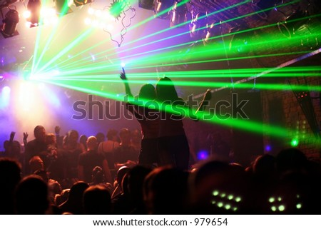 two woman dancing on a platform between laserlight in an underground-club - stock photo