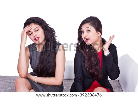 Two woman friends arguing