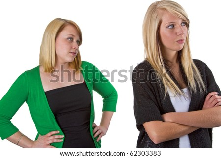 Two woman friends have an argue with each other- isolated on white background