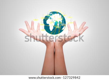 Two woman hands hold earth of social network