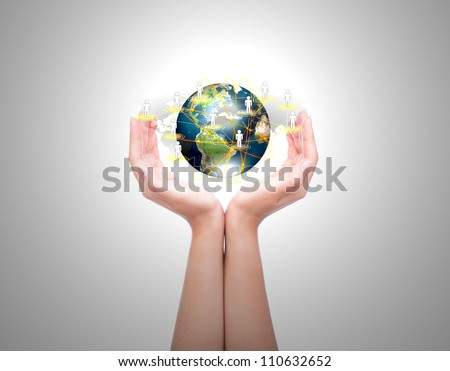 Two woman hands hold earth of social network (Elements of this image furnished by NASA) - stock photo