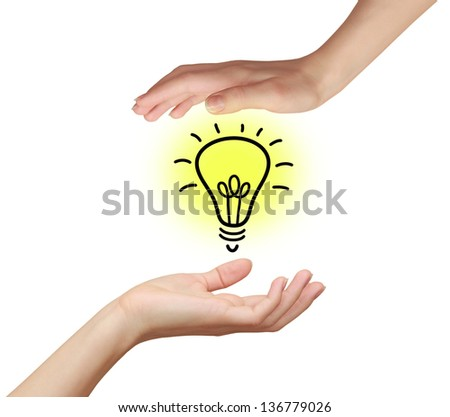 Two woman hands holding idea bulb with yellow light isolated on white background - stock photo