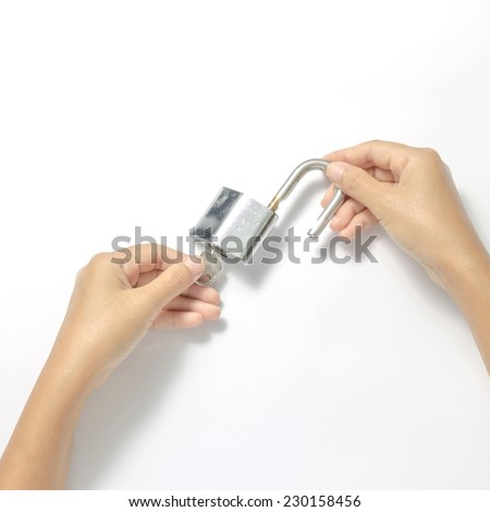 two woman hands open padlock with key on a white background