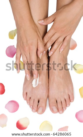 Two woman hands with moisturizer body cream - stock photo