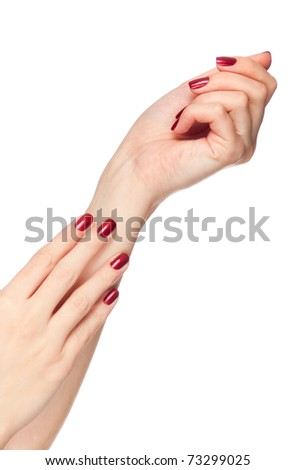 Two woman hands with red fingernail isolated - stock photo