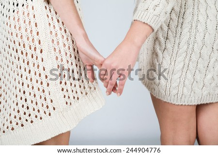 Two woman holding their hands, lesbian concept - stock photo