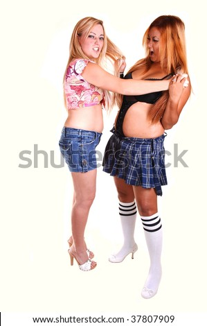 Two woman, one Asian and one Caucasian, fighting in the studio an pulling each others hair, in shorts and mini skirt and heels, for white background. - stock photo