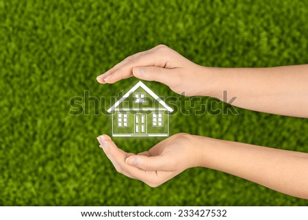 Two Woman's open hands making a protection gesture  isolated on green background.Property insurance and security concept . - stock photo