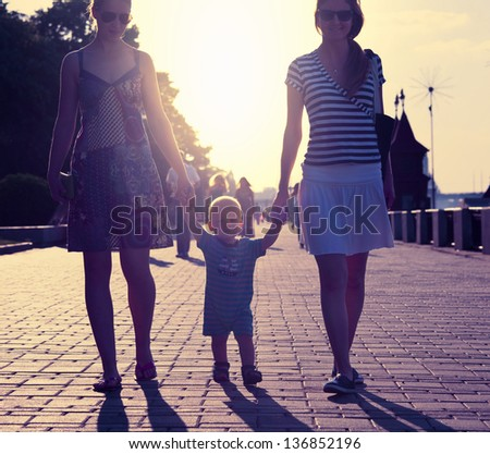 two womans and small boy - stock photo