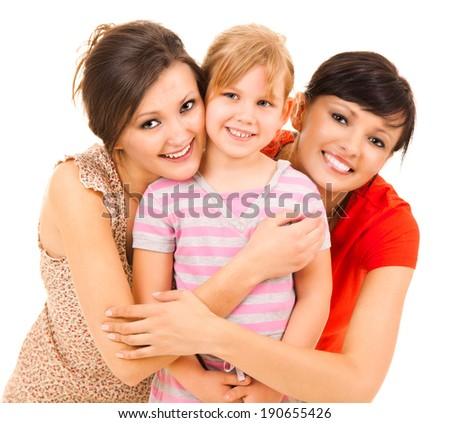 two women and girl, smiling, hugging each other, white background - stock photo
