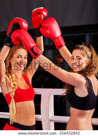 Two  women boxer wearing red  gloves to box in ring.  Fitness trainer. - stock photo
