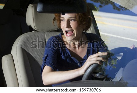 two women bracing for a car crash accident - stock photo