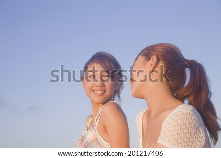 Two women chatting in the evening