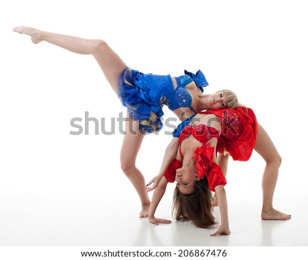 two women dance on a white background. studio shot - stock photo