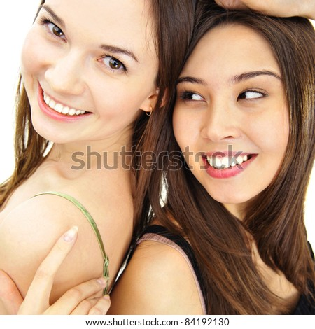 Two women dancing and smiling - stock photo