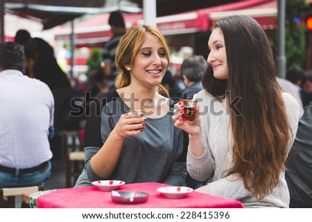 Two Women Drinking Cay, Traditional Turkish Tea, in Istanbul - stock photo