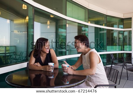 Two women drinking coffee - stock photo