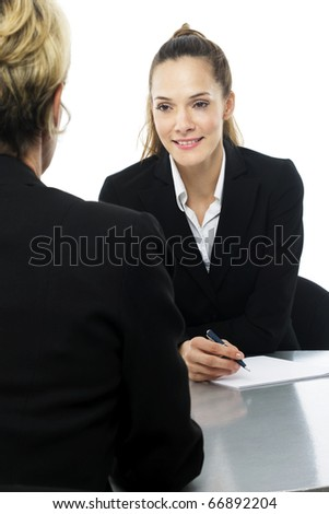 two women during a business meeting on white background studio