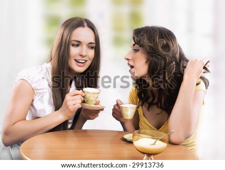 Two women enjoy a coffee break - stock photo