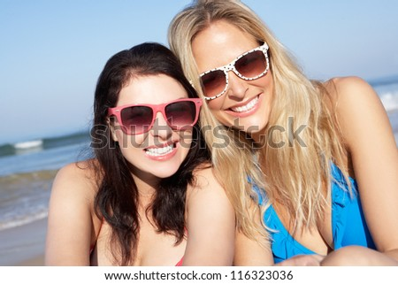 Two Women Enjoying Beach Holiday - stock photo