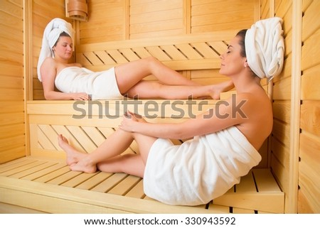 Two women enjoying their time in the sweating room.